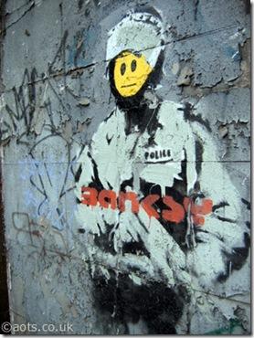 banksy_peeling_riot_cop